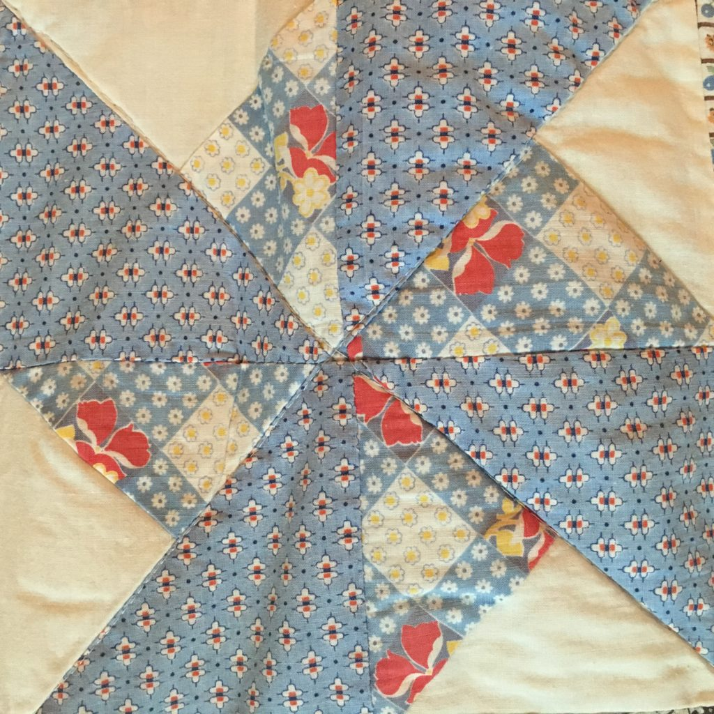 blue and white double pinwheel quilt block